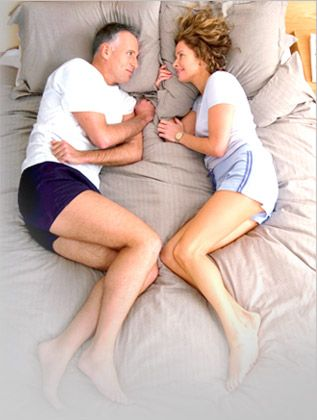 about-us-couple relaxed on mattress